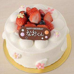 名前を書き入れたパレットプレートをケーキの上に